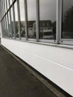 Fassade mit Filzputz und Anstrich mit Siliconharz-Fassadenfarbe